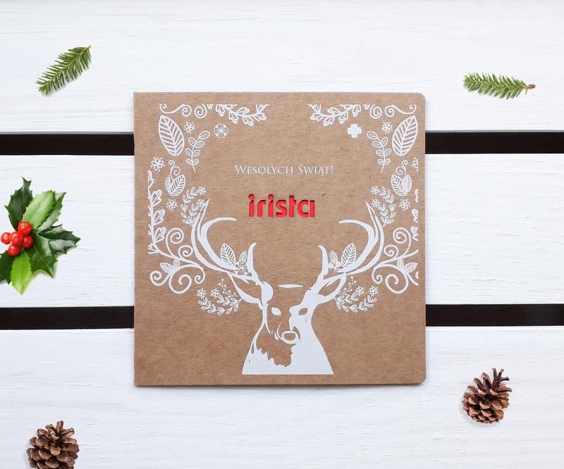 Kartki świąteczne z wyciętym laserowo logo z białym nadrukiem renifera